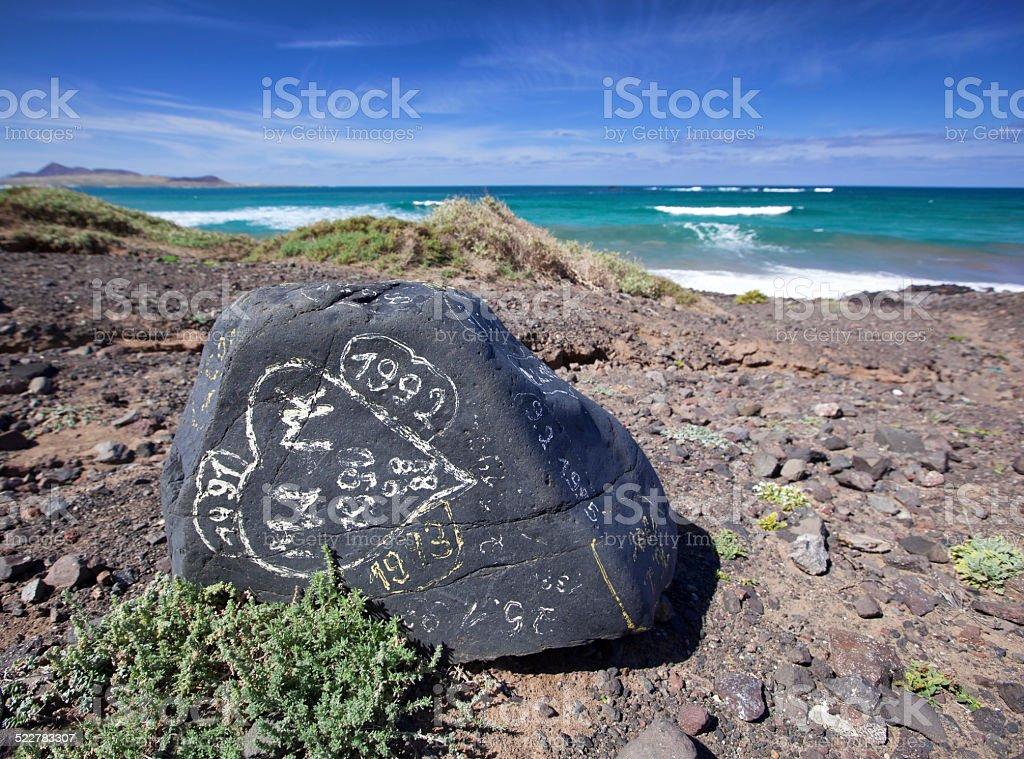 Painted rock at Playa de Famara royalty-free stock photo
