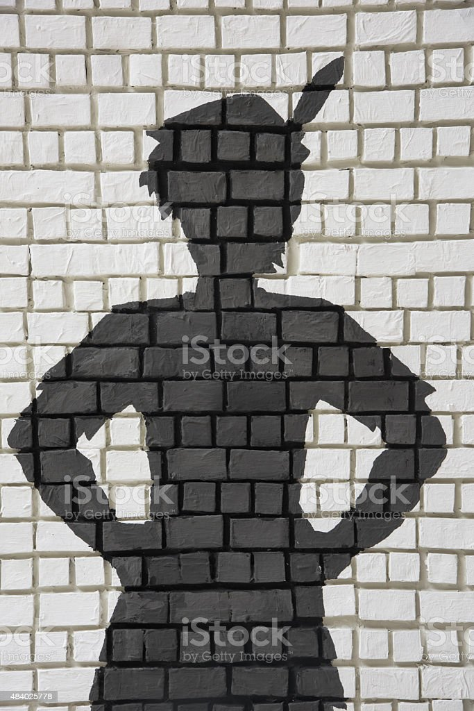 Painted silhouette Peter Pan on wall stock photo