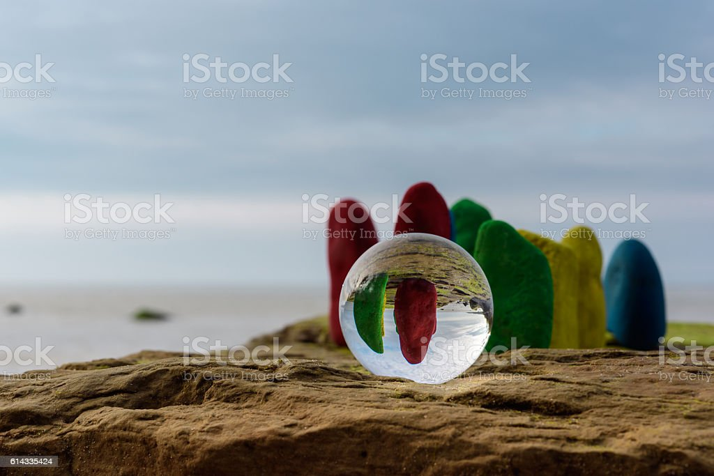 Painted stones and crystal ball stock photo