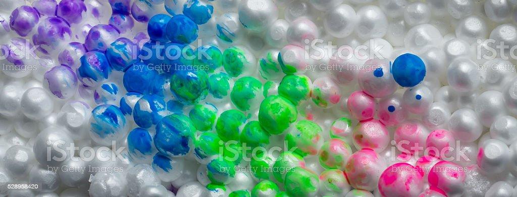 painted styrofoam balls stuck on wall close-up stock photo