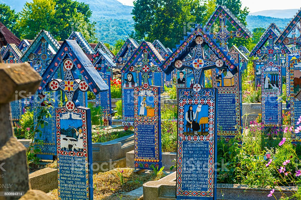 Painted wooden crosses in the Merry Cemetery in Maramures stock photo