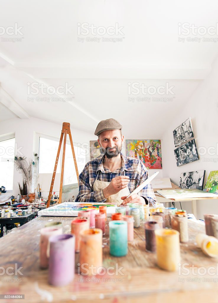Painter at his workshop creating new artworks stock photo