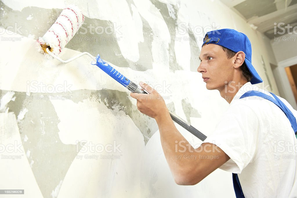 painter at home renovation work with prime stock photo
