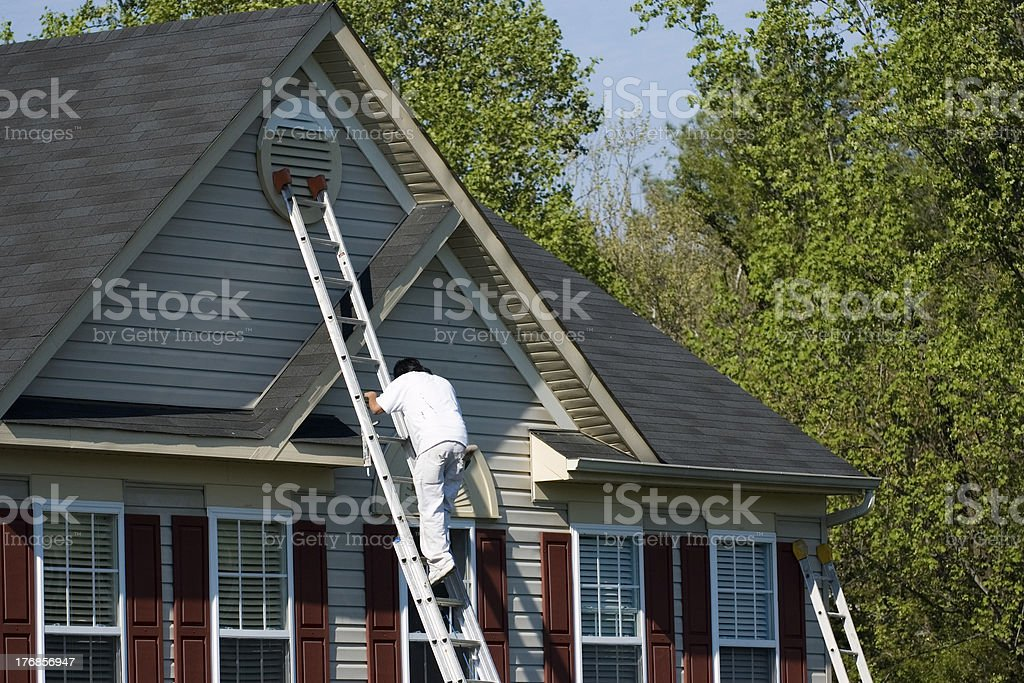 Painter Climbing Ladder stock photo