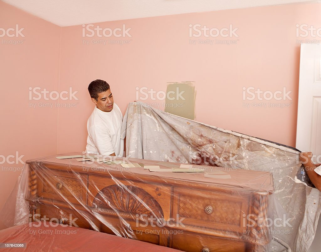 painter covering furniture royalty-free stock photo
