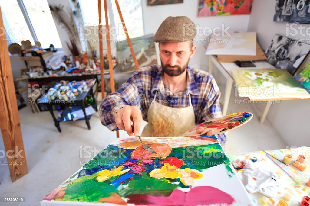 Painter creating art at his workshop stock photo