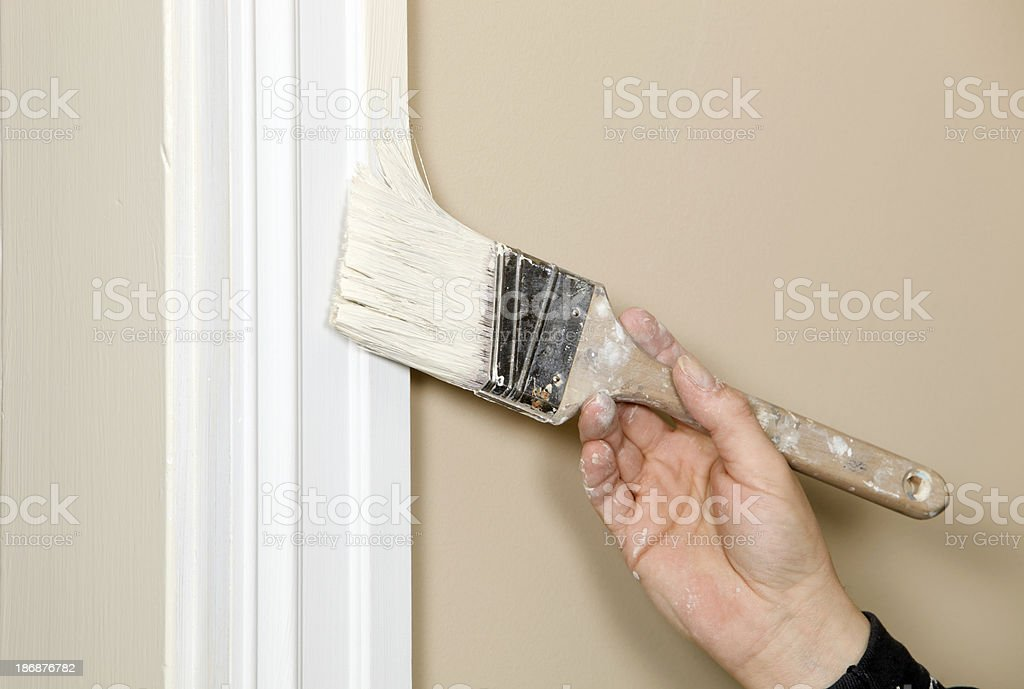 Painter Cutting In Trim to Wall royalty-free stock photo