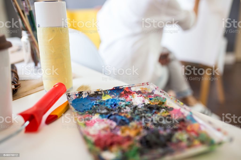 Painter equipement easel colors wood workspace stock photo