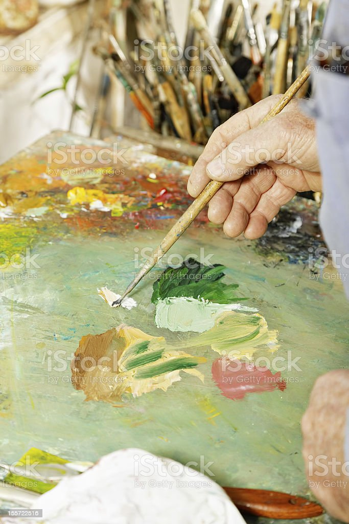 Painter hands mixing paints stock photo