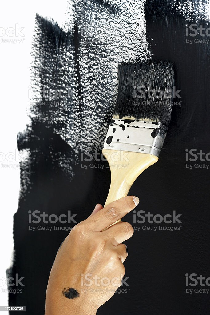 Painter in action stock photo