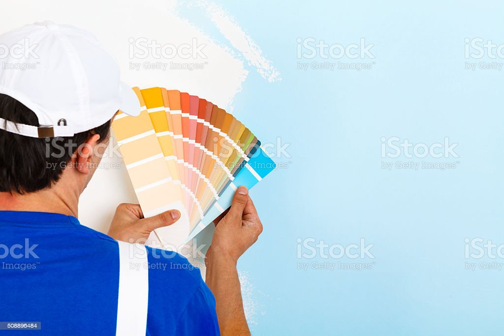 painter man looking a color palette stock photo