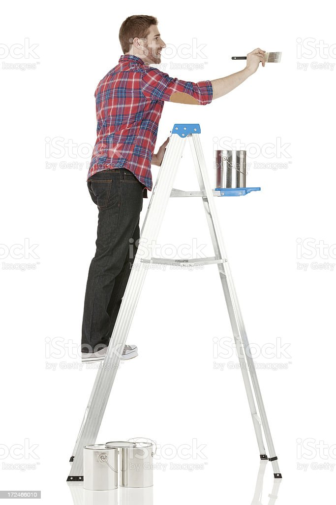 Painter painting a wall royalty-free stock photo