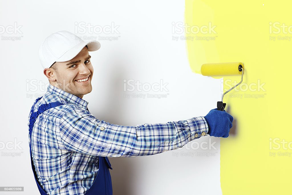 Painter painting a wall stock photo