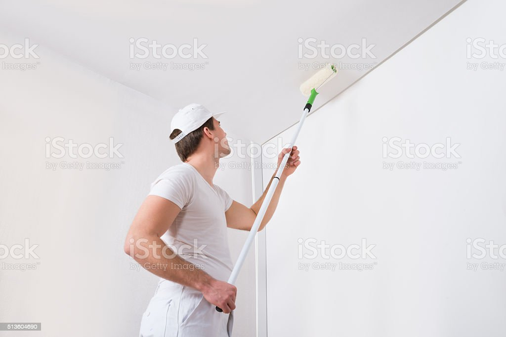 Painter Painting On Wall stock photo