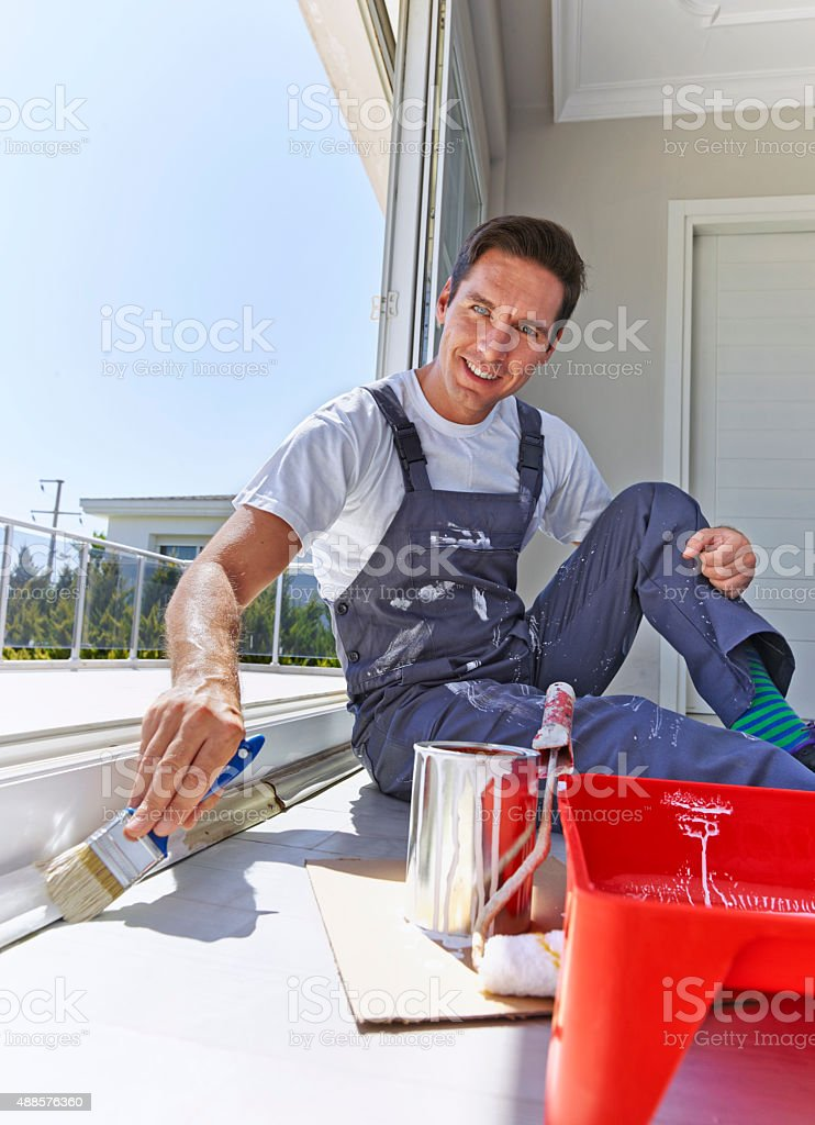 Painter painting window trim stock photo