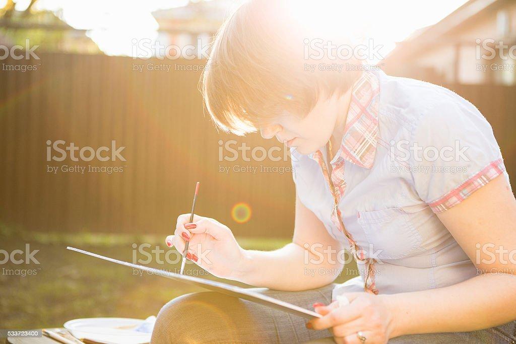 painter paints a painting stock photo