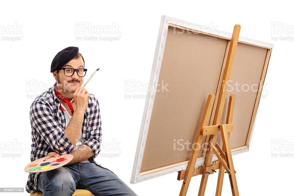 Painter posing next to a canvas stock photo
