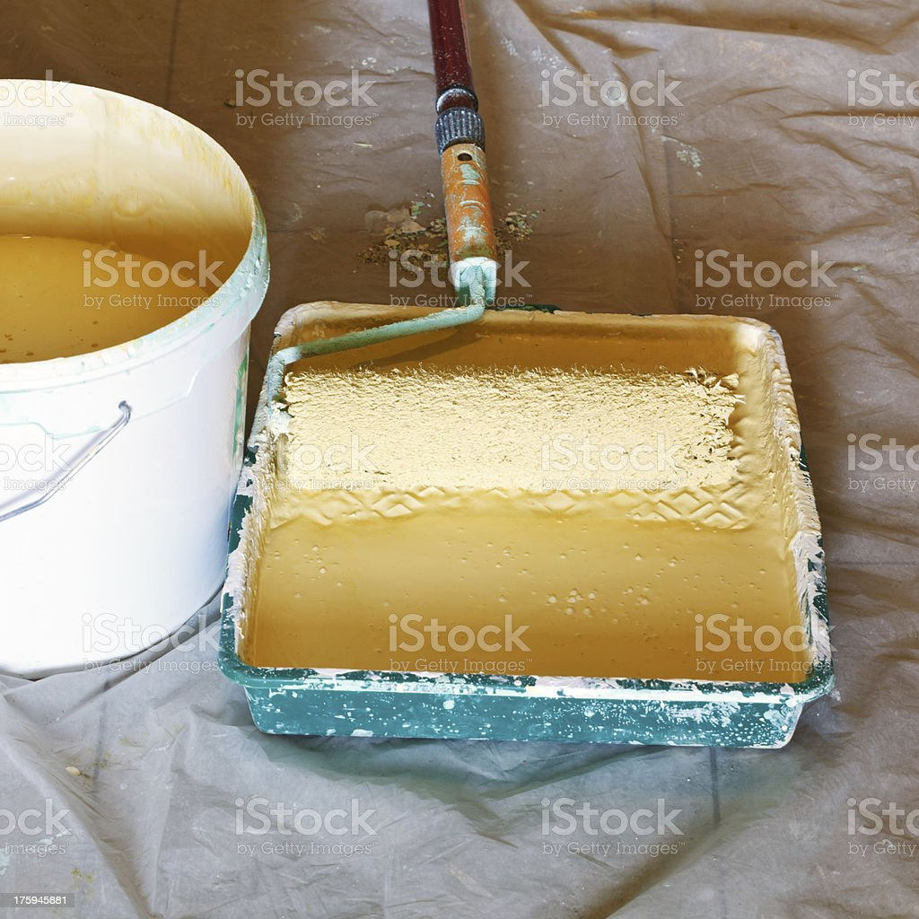 painter roller brush and bucket with paint stock photo