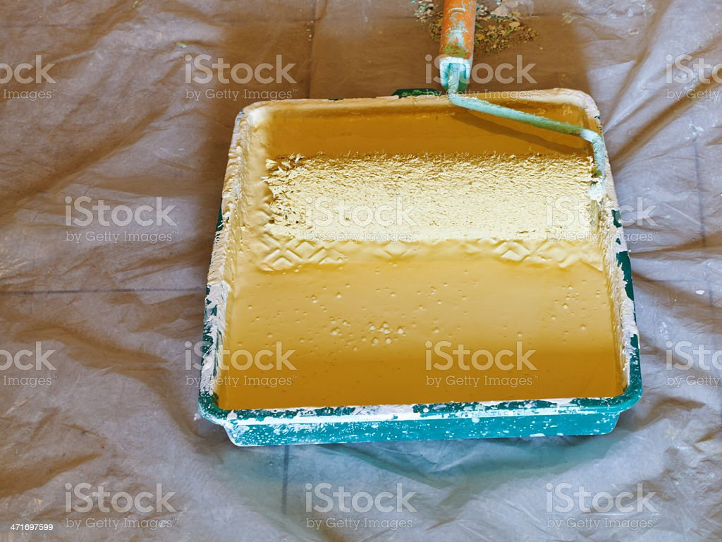 painter roller brush in plastic paint tray stock photo