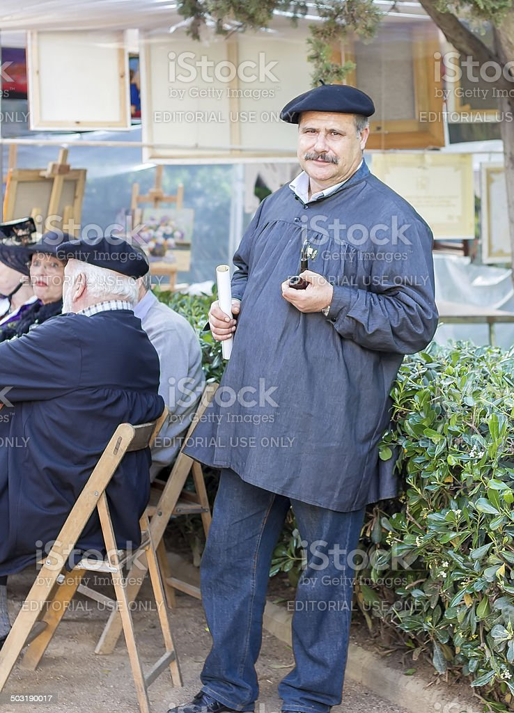 painter showing his paintings in the modernist fair stock photo