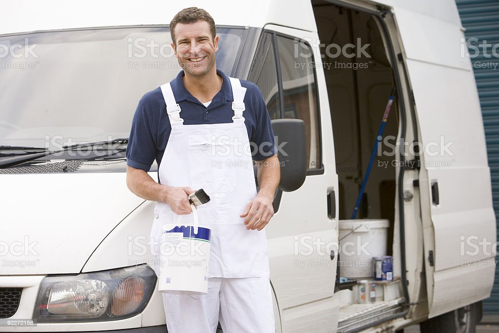 Painter standing with van stock photo