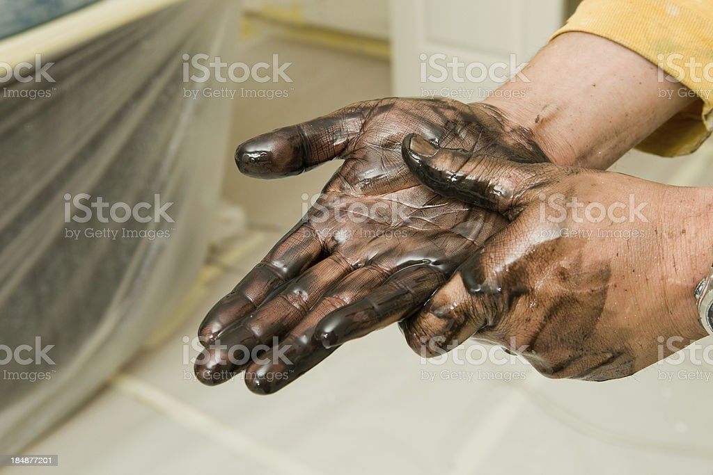 Painter Washing Stained Hands with Lacquer Thinner stock photo