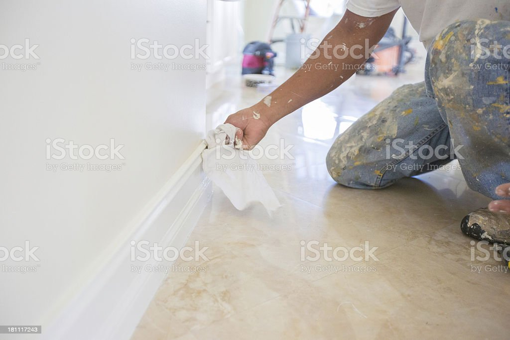 painter wiping wood trim royalty-free stock photo