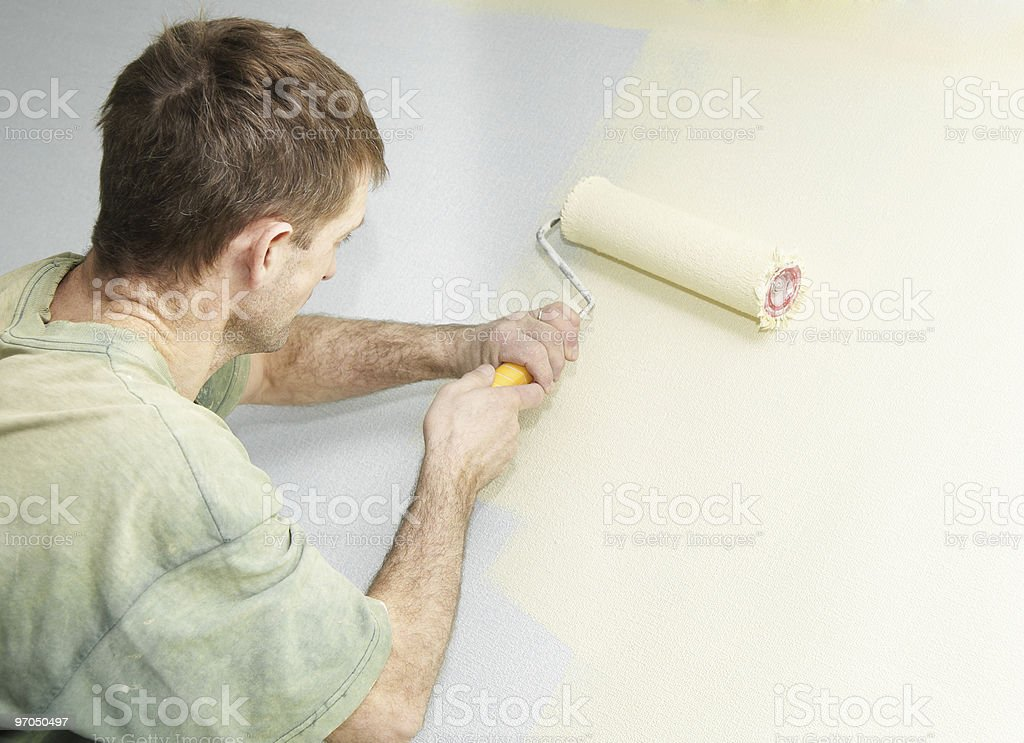 Painter with roller royalty-free stock photo