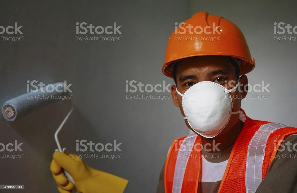 Maler Arbeiter die Arbeit zur Sicherheit am Arbeitsplatz Lizenzfreies stock-foto