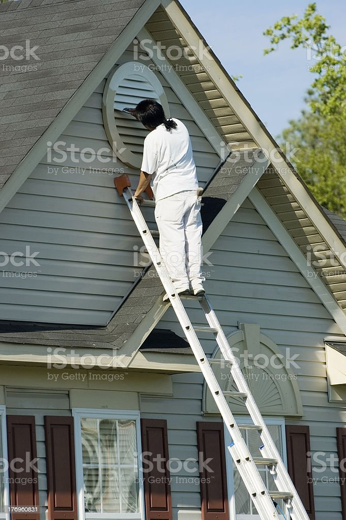 Painter Working at Roofline royalty-free stock photo