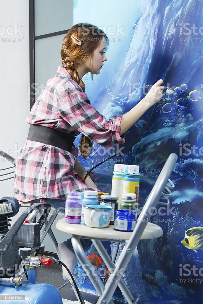 Painter working on mural in personal residence stock photo