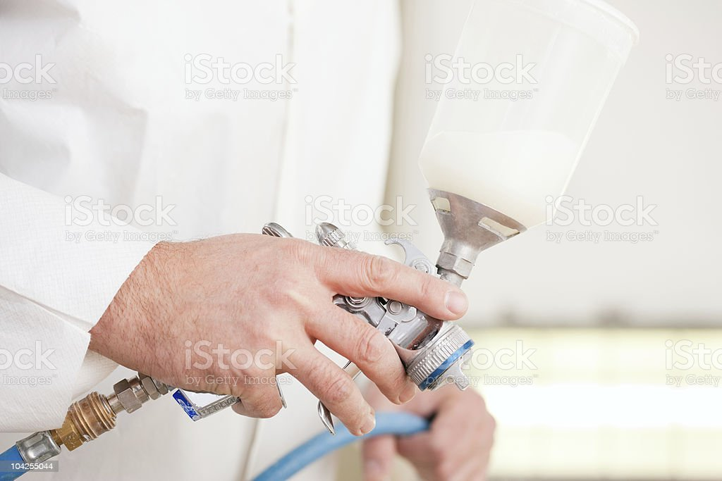 Painter working with spray paint royalty-free stock photo