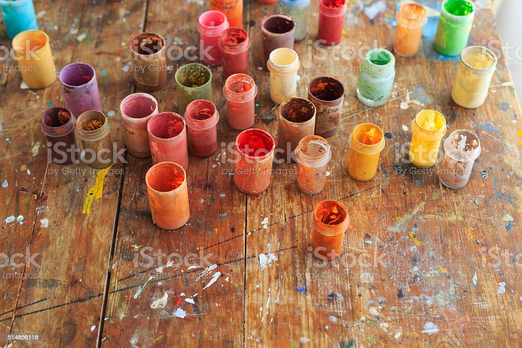 Painter's dyes on table stock photo