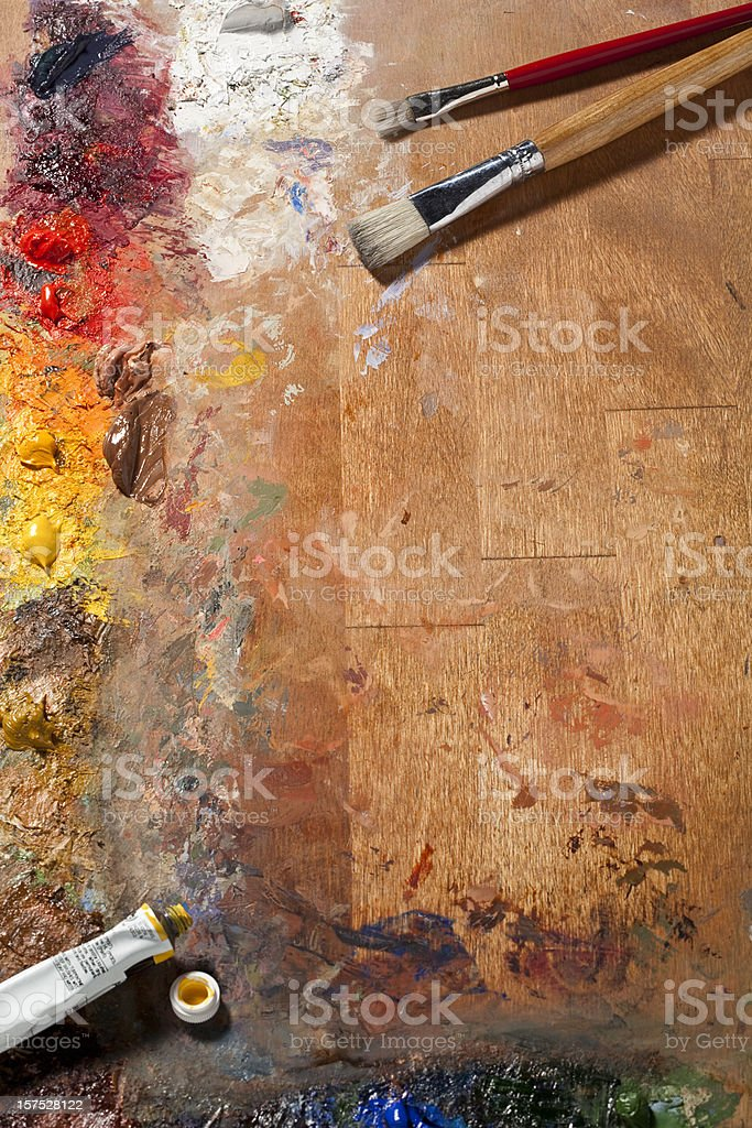 Painters Palette and Brushes. Full Frame, Vertical. stock photo