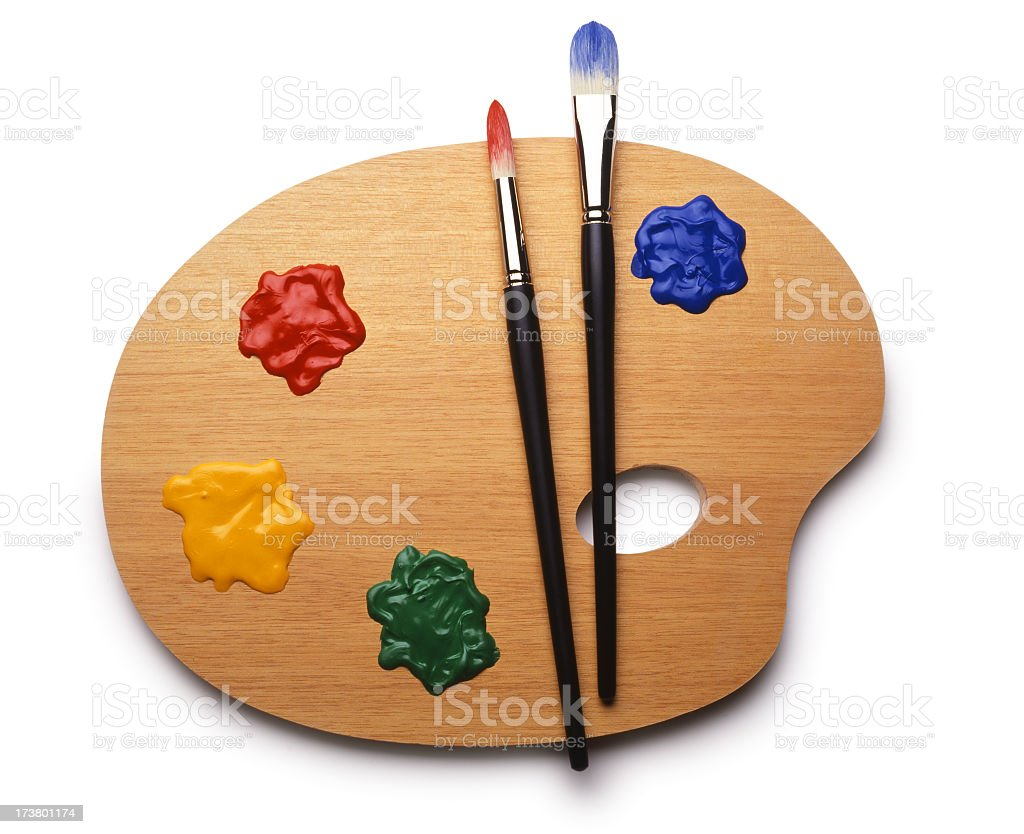 Painter's palette and paint brushes on white background stock photo