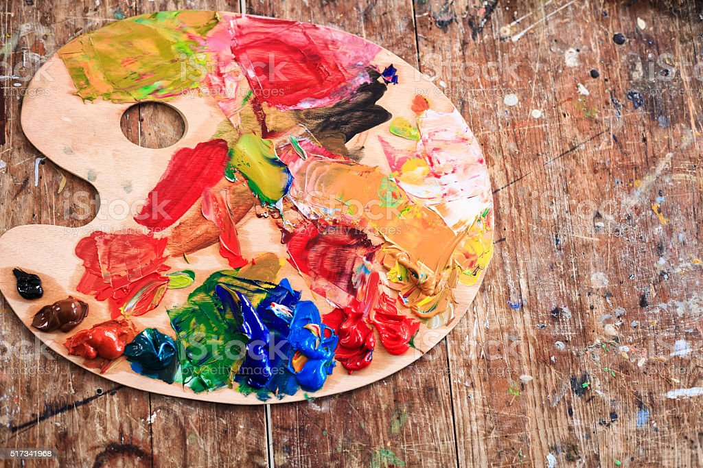 Painter's palette on table stock photo