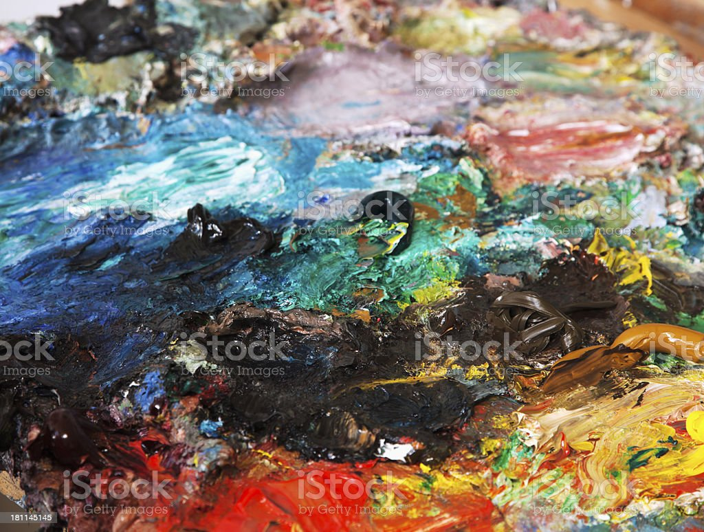 Painter's  palette  with mixture of different colors. royalty-free stock photo