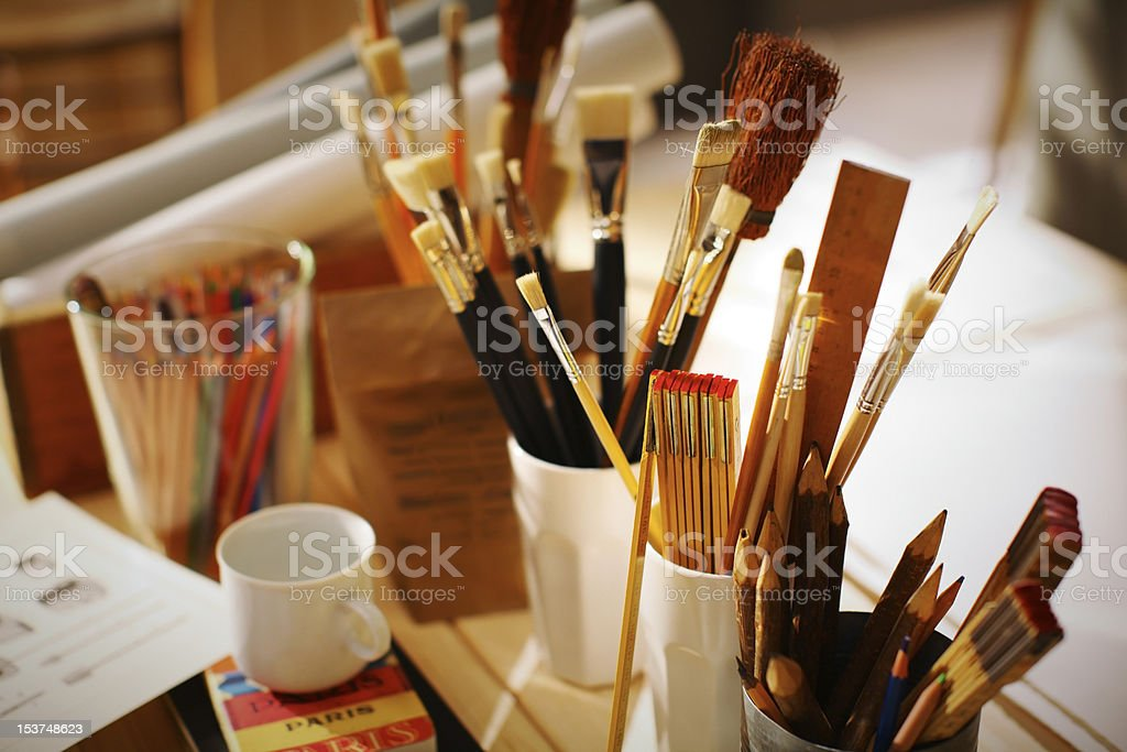 Painters tools at the workplace stock photo