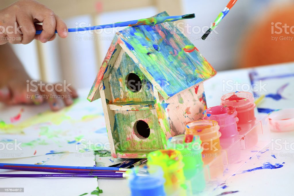 Painting a Birdhouse stock photo