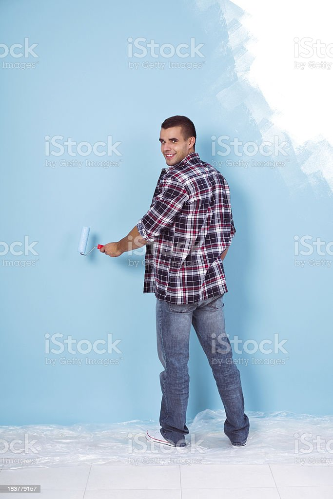 Painting a blue wall royalty-free stock photo