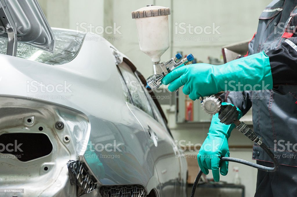 painting a car stock photo