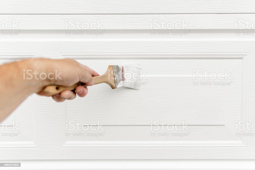 Painting a Garage: Hand Painting a Garage stock photo