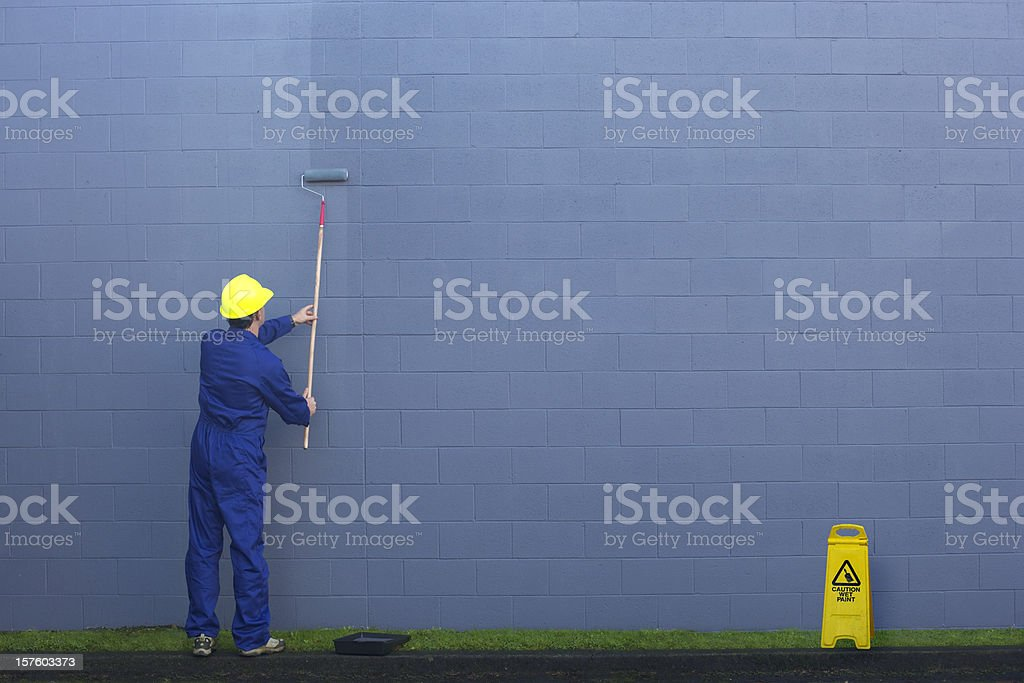 Painting a wall outside. stock photo