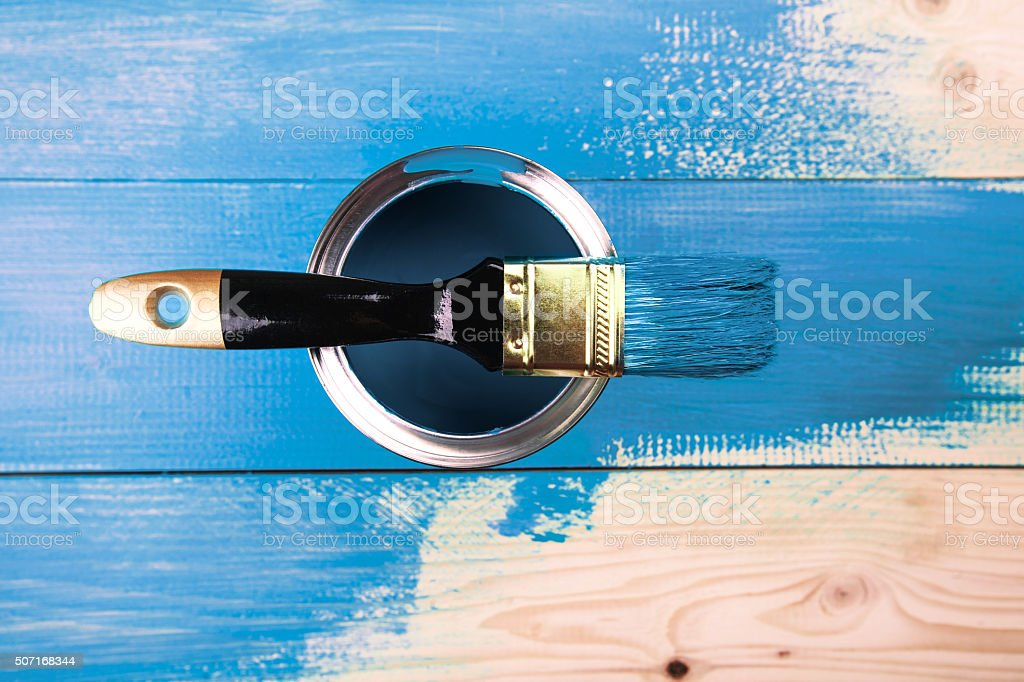 Painting a wooden shelf using paintbrush stock photo