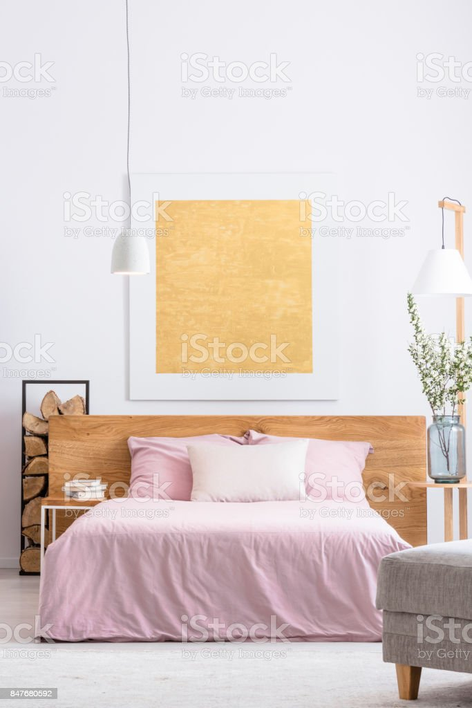 Painting above the bed stock photo