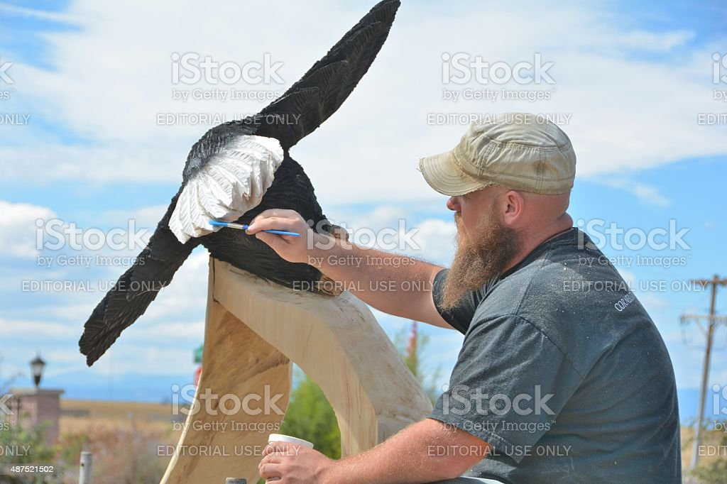 Painting an Eagle Carving stock photo