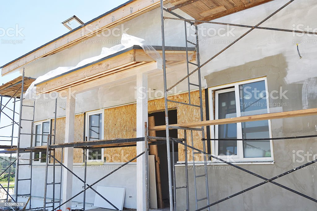 Painting and Plastering Exterior House Wall. stock photo