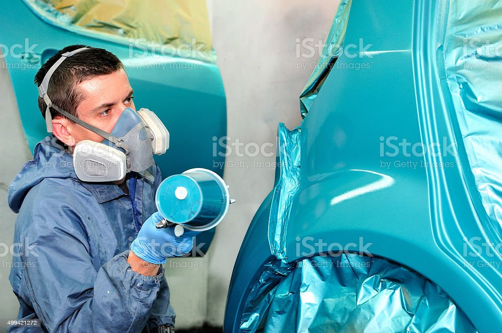 Painting blue car. stock photo