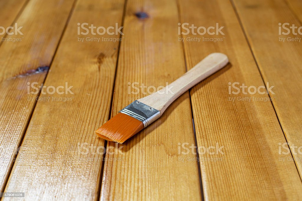 painting brush on wooden table stock photo