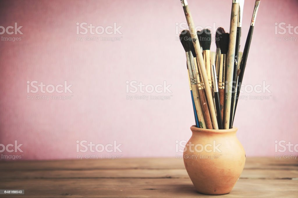 painting brushes on  the wooden table stock photo